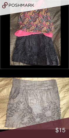 Denim skirt with pockets and fringe flower details Medium denim colored skirt, cute fringe flower details, pockets, so cute!!! Skirts Mini