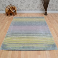 Holborn Striped Rugs in Pastel are handmade in India with a thick, silky, 100% Viscose pile. This sophisticated collection offers a beautiful lustre and will bring luxury and style to any room in your home.