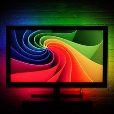 Lightpack is a set of RGB LED strips that stick to the back of your TV or monitor. The LEDs change color based on the content of the screen, creating a more immersive experience for all your games, movies, and more. $180