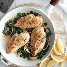 Lemon-garlic chicken with creamy spinach - Chatelaine Ways To Cook Chicken, Easy Chicken Recipes, Easy Dinner Recipes, Yummy Recipes, Chatelaine Recipes, Lemon Garlic Chicken, Creamy Spinach, Spinach Stuffed Chicken, Cooking Recipes