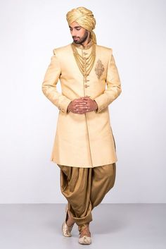 MFS Beige Embroidered Sherwani With Golden Peshwari Salwar #flyrobe #groom #groomwear #groomsherwani #sherwani #flyrobe #wedding #designersherwani