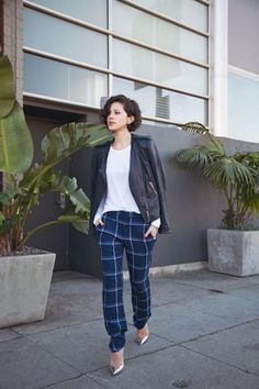 Plaid pants are tricky to pull off. The secret is to wear them with simple pieces; keep them the focus of your outfit. #plaid #fallstyle