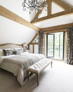 Border Oak vaulted ceiling in bedroom with balcony