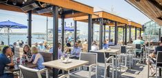 Lakeside patios in Toronto are somewhat scarce, making by the water seating a hot commodity in the summer. Best Restaurants In Toronto, Scarborough Bluffs, Sunny Afternoon, Restaurant Concept, Pool Bar, Made In Heaven, Months In A Year, Types Of Food, South Beach