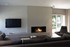 Modern luxury living room fireplace sectional minimal sophisticated interior design by Piet Boon Fireplace Tv Wall, Modern Fireplace, Living Room With Fireplace, Fireplace Design, Living Room Decor, Floating Fireplace, Small Fireplace, Fireplace Ideas, Interior Architecture