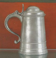 "Pook & Pook. November 11th & 12th 2011.  Lot 333.  Estimated: $20K - $30K. Realized Price: $17010. Philadelphia pewter tankard, ca. 1775, bearing the touch of William Will, with wrigglework inscription on base AS 1775, 7"" h."
