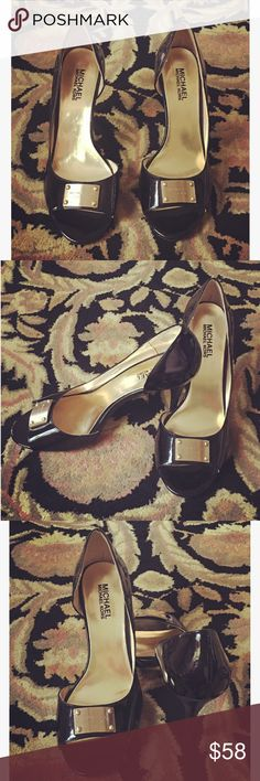 Michael Kors Heels  Brand: Michael Kors. Style: Leather heels with gold Michael Kors emblem on front. Color: Shiny Black. Heels: 4 inches. Condition: Used / Good. Small scratch on bottom of left heel. Michael Kors Shoes Heels