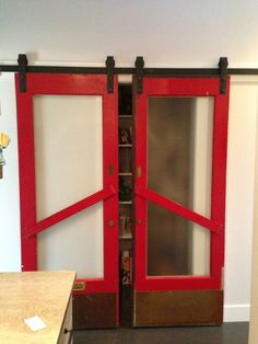 Theaters have provided wonderful pieces for DIY reuse. Houzz user mirandahastings repurposed doors from a 1930s movie theater. She hung them on barn door hardware, and they now cover the pantry.