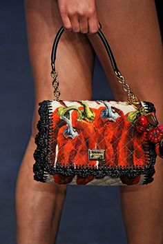 I love this Dolce & Gabbana hot pepper purse, but that left leg is so distracting, like, is that a dude? It looks like a dude leg