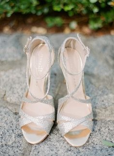 Strappy metallic wedding shoes: http://www.stylemepretty.com/massachusetts-weddings/2015/01/08/seaside-art-gallery-wedding-in-rockport/ | Photography: Arielle Doneson - http://www.ariellephoto.com/