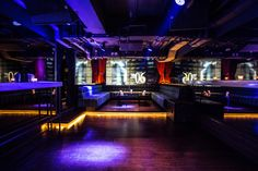 7 Heaven night club in Lan Kwai Fong, Hong Kong designed by Liquid Interiors. night club design, nightlife design, VIP booth design, lit stairs, projection screens, colorful lighting, simple and modern