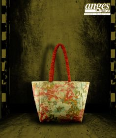 A dense floral digital print on an organic bag is a great way to sport on a summery day with a matching scarf and a cap on a white boho shirt and tan shorts.