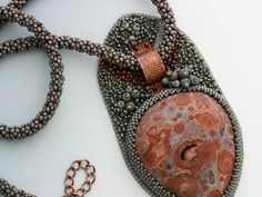 Bead Embroidery Pendant Necklace. Mine shaft basalt cabochon.