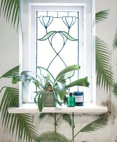 bringing the outside in, love the stained glass window and fern wallpaper #decor #interiors
