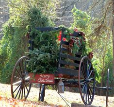 Merry Christmas Wagon loaded down with Christmas tree, packages, garland and decorations. #Country #Wreath #Boho
