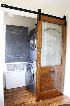 Tiny laundry room idea - this unused closet transformed into a laundry room. LOVE the sliding door!