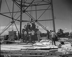 """Nuclear Gadget being raised to the top of the detonation """"shot tower"""", at Alamogordo Bombing Range; Trinity nuclear test, July 1945 Not identified. - http://ma.mbe.doe.gov/me70/history/photos.htm"""