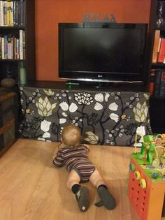 Baby proofing tv stand skirtori could use it to hide all the tv components i don't like to look at. Toddler Proofing, Baby Proofing Ideas, Diy Tv Stand, Zeina, Childproofing, Baby Safety, Safety Tips, Baby Time, Baby Hacks