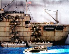 """Transports were not the biggest ships in the U.S. Navy during WWII, but a 1/35 scale troop ship is a humongous undertaking. In that scale, master modeler Lewis Pruneau built this scene with landing craft and more than 200 figures — but only a section of the ship. """"Otherwise,"""" he says, """"that thing would have been 17' long!"""" Still, it is about 2' tall."""