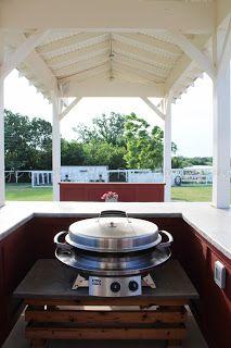 Evo grill in farmhouse outdoor kitchen