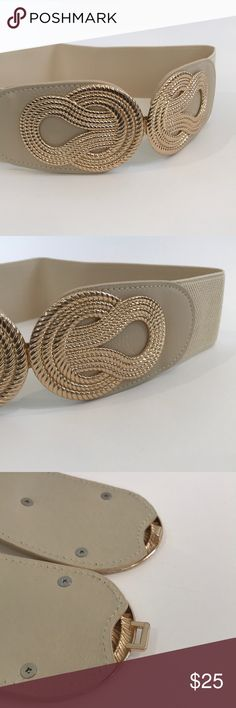 "Stretch Belt - Cream w/Gold Front-Close Buckle Such a versatile belt!  Wear over tops or dresses to add a little flair and change the look of your outfit.  Belt measures 13"" lying flat, so would fit a 26"" - 29"" waist comfortably. Accessories Belts"