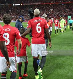 Paul Pogba of Manchester United walks out at Old Trafford ahead of the Premier League match between Manchester United and Southampton at Old Trafford on August 19, 2016 in Manchester, England.