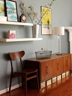 Open shelving works fantastic on any wall! What a rad idea for hallway shelving! White floating shelves are sweet!