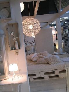 Pallet bed. love the all white.