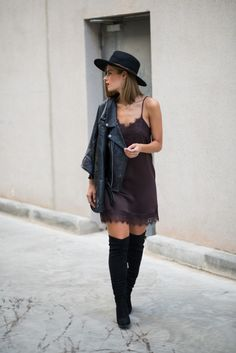 justthedesign:  A little lace fringed dress will always afford you a sexy feminine style which is adaptable and will work with almost anything. Throw a leather jacket on over yours and try the new and in demand pyjama style likeMs Treinta.  Dress: Buylevard Biker Jacket/Boots/Hat: Zara Bag: Formula Joven.