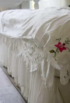 Make a corner doona cover feature from a tablecloth or doily that's seen better days