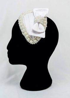 Bridal headpiece, available from Falabella .
