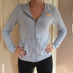"""PINK Zip-up Size small pink zip-up. Light blue in color with neon orange writing. """"PINK"""" written along the hood. Perfect condition  Victoria's Secret Sweaters"""