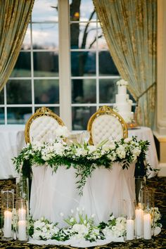 We draped this sweetheart table in a sheer gray and surrounded it with greenery, white florals and candles, which was perfect for this rustic winter wedding. Head Table Wedding, Wedding Table Linens, Bridal Table, Wedding Table Decorations, Wedding Centerpieces, Wedding Reception, Tall Centerpiece, Farm Wedding, Floral Wedding