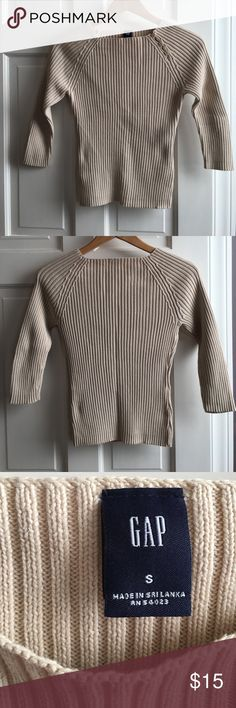 Tan ribbed cotton sweater I loved this sweater so much! My favorite look was to wear this with jeans and add a pop of color by layering it with a long sleeved cotton shirt. It's fitted and flattering, hits at waistline. There is a stain on the inside that is not visible from the outside (see photo and do not try to dry your clothes on a metal radiator). GAP Sweaters Crew & Scoop Necks
