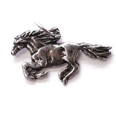 A wild galloping horse cast in lead free pewter. Handmade in Colorado. Horse Stalls, Wild Horses, Pewter, Lion Sculpture, Pendant, Jewelry, Tin, Jewlery, Jewerly
