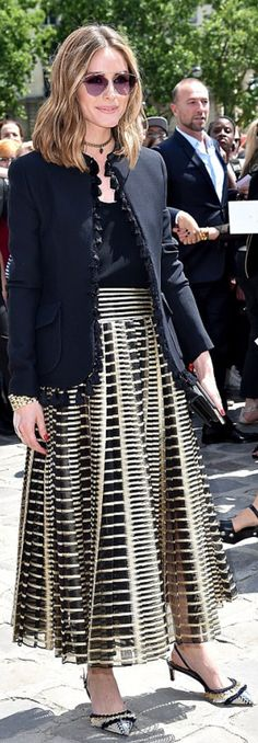 Who made  Olivia Palermo's print skirt, black jacket, and pink sunglasses?