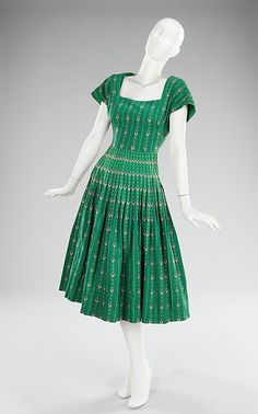 Dress  Carolyn Schnurer  (American, born New York City, 1908–1998 Palm Beach, Florida)  Manufacturer: Textile by Dan River Mills (American) Date: 1950 Culture: American Medium: cotton Dimensions: Length at CB: 43 in. (109.2 cm) Credit Line: Brooklyn Museum Costume Collection at The Metropolitan Museum of Art, Gift of the Brooklyn Museum, 2009; Gift of Carolyn Schnurer, 1951