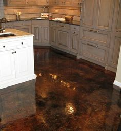 Acid stained concrete flooring with gloss finish. No grout to clean!