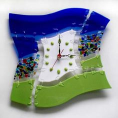 A glass handmade wall clock of fused glass in fusing technique