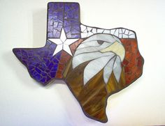 "Texas Shaped Garden Stone with Eagle by Lynn Fullerton. The Texas State flag with a beautiful Eagle on a Concrete Stone, reinforced with wire 18"" in diameter.With striking colors of Red,White and Blue which is a perfect combination for the Eagle. This is glass cut and fitted to the concrete, mosaic style. Price: $65.00 On Artful Vision,  a portion of your gift purchase is donated to a participating non-profit of your choice."