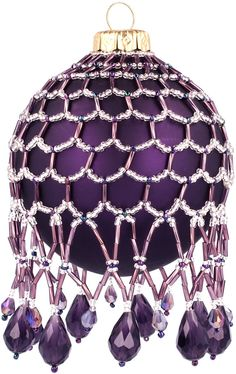 Purple caged and beaded ornament..