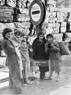 Spain - 1939. - GC - A family of refugees from the Spanish civil war at the border between France and Spain.