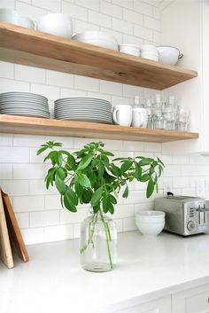 subway tiles + wooden shelves.