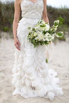 Scalloped Enaura Bridal dress: http://www.stylemepretty.com/2015/07/23/the-35-most-beautiful-bedazzled-wedding-dresses/