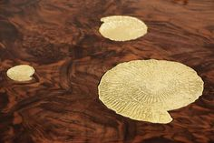 Metamorphosis Dining Table by Boca do Lobo | This luxury dining table has come to symbolize the evolutionary history of life, representing the last stage of the cycle through the usage of sculpted fossils on display at the top of the table. Metamorphosis embodies handmade techniques such as wood carving, metal cutting and hammering, and polishing, executed by some of the best craftsmen in the country. A unique product for those who have a peculiar taste for limited edition pieces and…