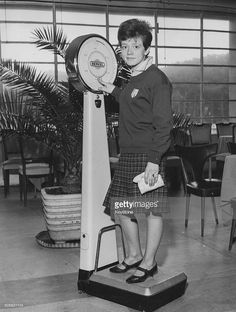 Portrait of Italian teenage singer Rita Pavone, wearing her school uniform and standing on a set of scales, Rome, February (Photo by Keystone/Hulton Archive/Getty Images) School Uniform, Rome, February, Portrait, Celebrities, Lady, Bella, Singers, Stage