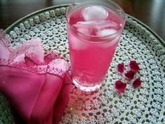 Gül serbeti (Turkish rose drink)  Per person:  1T rosewater  1T sugar  1T lemon juice  1c water  drop of food colouring  ice cubes