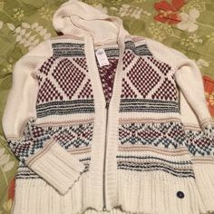 Hollister Hoodie with Zipper Brand new with tags - retail price: 70$ - small size 55% acrylic, 25% wool, 20% nylon - zipper on the front - very cute and warm with a hoodie - burgundy, green and white colors Hollister Sweaters