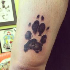 25 Dog Paw Tattoo Ideas to Showcase the Special Bond with Your Canine Dog Pawprint Tattoo, Dog Tattoos, Animal Tattoos, Print Tattoos, Hand Tattoos, Family Tattoos, Tatoos, Dog Paws, Get A Tattoo