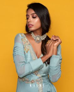 #MeriahCollection#TheFestiveEdit The canal blue festive outfit illustrates modern resort elegance amalgamated with the culturally rooted Indian design aesthetic. With the voguish wrap-around style + the minimal running embroideries, it is sure to make you look like a million bucks. This as your sartorial selection for the upcoming celebrations is breezy and beautiful. 🧚♀️ You Look Like, Festival Outfits, Celebrations, Festive, Minimal, Beaded Necklace, Chiffon, Indian, Running